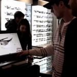 Les écrans tactiles permettent de capter l'attention des clients du magasin Sport Check
