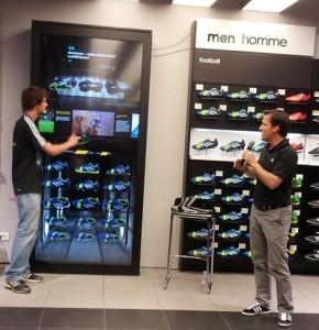 Grand écran tactile et connecté, le virtual footwear wall d'Adidas a été installé dans le magasin des Champs Elysées.
